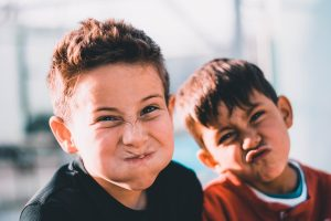 Two kids pulling funny faces